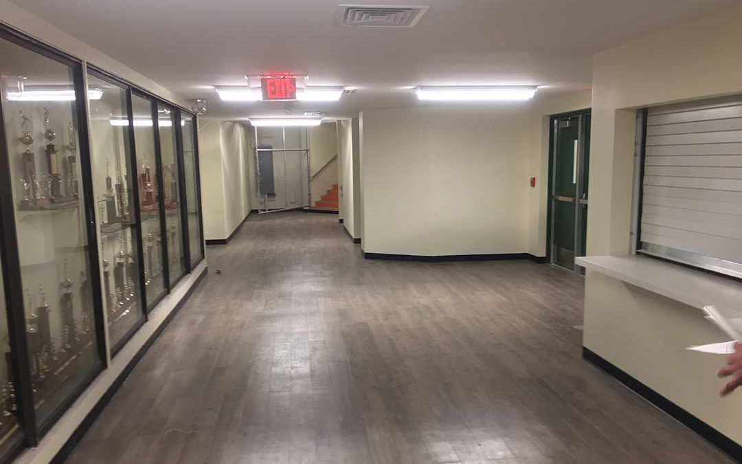 after image of a high school gym lobby