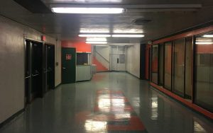 before image of a high school gym lobby