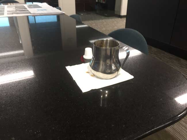 Cafecito serving carafe on a conference table top